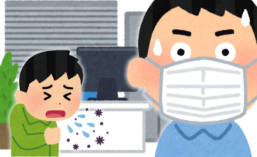 社内でコロナウイルスにおびえる男性